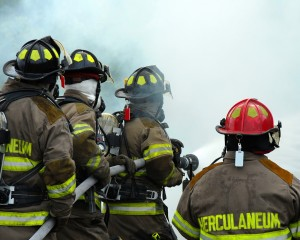 bigstockphoto_firemen_fighting_1360970